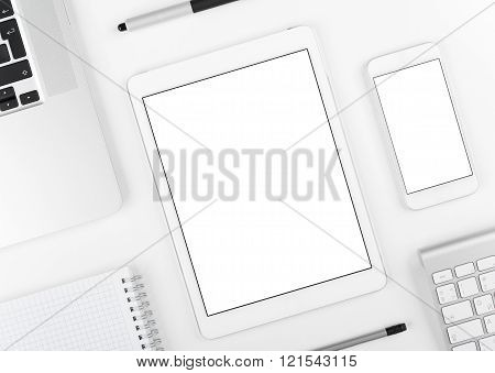 Responsive design: Laptop tablet and smartphone on white table