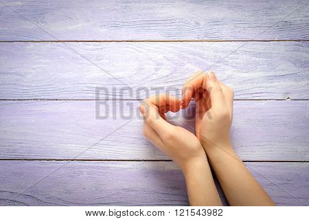Woman Hands Making A Heart Shape On A Wooden Background With Copy Space