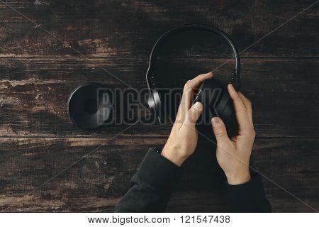 Top View Two Hands Change Earpads On Wireless Headphones
