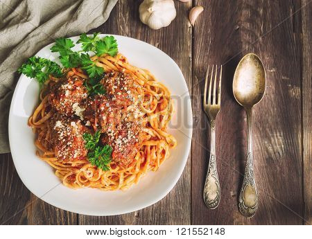 Linguine Pasta With Meatballs In Tomato Sauce And Parsley