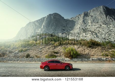 Crimea, Russia - September 20, 2015: Red Car Mazda Standing On The Road Near Mountains At Daytime