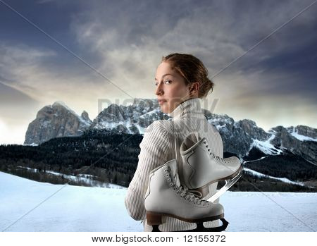female ice skater portrait against a mountain landscape