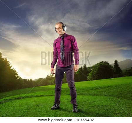 man listening music in a beautiful natural landscape