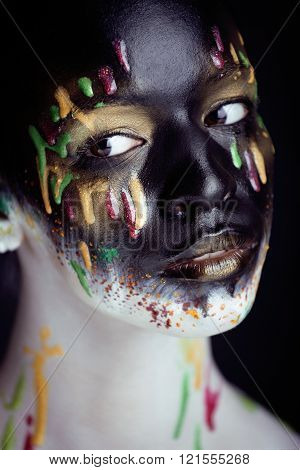 woman with creative makeup closeup like drops of colors, facepaint close up halloween