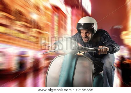 man riding old moped in a city street