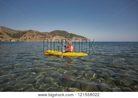 Man floating in the sea kayak.