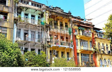 Yangon Myanmar - March 9 2015: A street archtecture view with colonial building in the town of Yangon