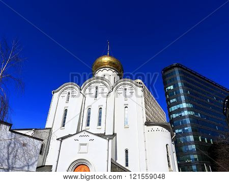 Church on the background of modern high-tech building
