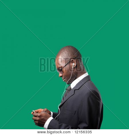 black businessman with mp3 player