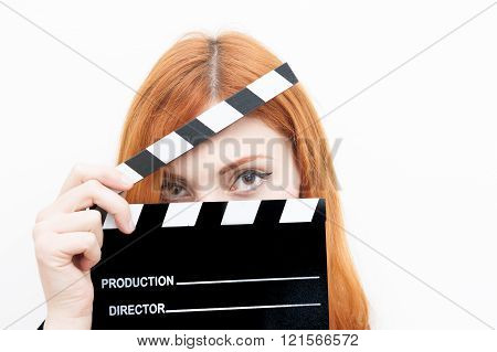 Young Redhead Woman With Clapper Board