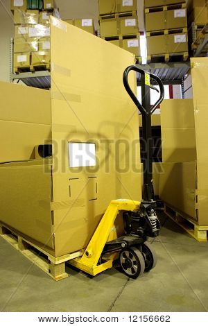 yellow fork lifter in warehouse
