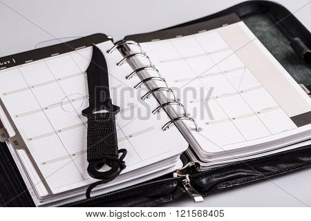 Murder Planning Concept - Calendar And Knife