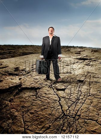 businessman with suitcase in the desert