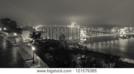 Panoramic View On Budapest At Night, Hungary, View On The Chain Bridge and the Parliament, Black And White