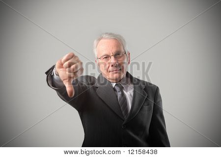 Portrait of a senior businessman with thumbs down