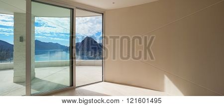 Interior of modern penthouse with wide terrace, empty room