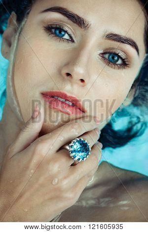 Woman In Pool with a Sapphire ring on