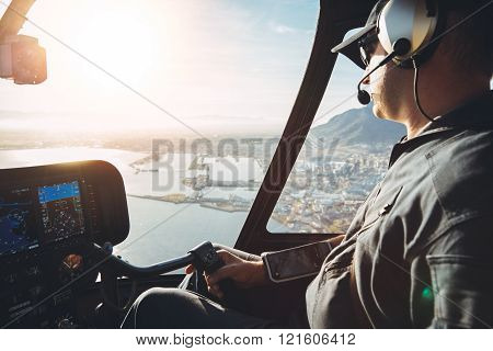Pilot In Cockpit Of A Helicopter