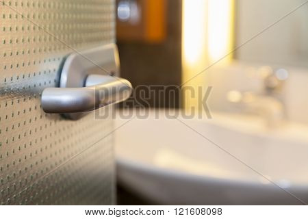Bathroom Door With White Lavatory In A House