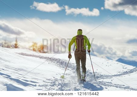 Man In Winter Landscape With Snowshoes