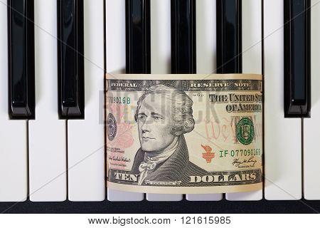 Piano Keyboard And Us Dollar Banknote