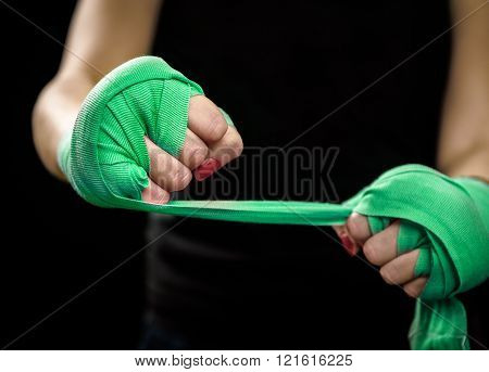 Woman Is Wrapping Hands With Green Boxing Wraps