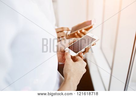 Closeup image of a women are chatting in network on their cell telephone during free time