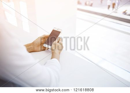 Female watching video in web via cell telephone during free time