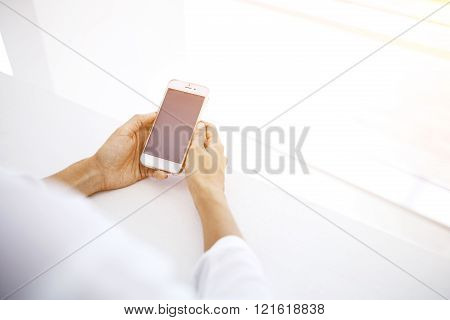 Female is browsing information in network via cell telephone