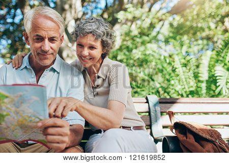 Happy Senior Tourist  Reading Map