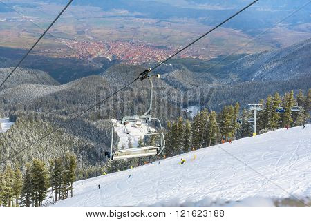 Bansko, Bulgaria - March 4, 2016: Bansko ski resort  aerial view, chair lift, people skiing on slopes, town panorama