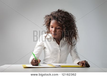 young black woman writing