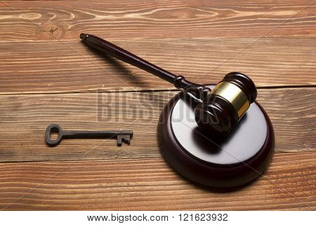 Judges Auctioneer Gavel, Retro Door Key On The Wood Table. Concept For Trial, Bankruptcy, Tax, Mortg