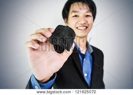 Businessman showing coal,selective focus on coal