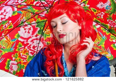 Red hair and umbrella