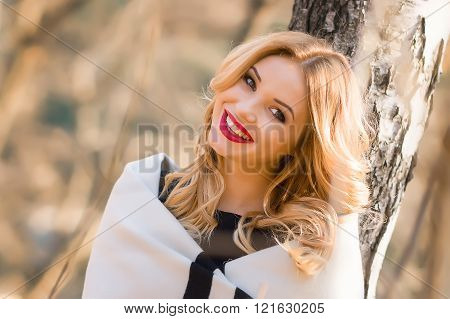 Portrait  beautiful girl who smiles while walking in the  forest