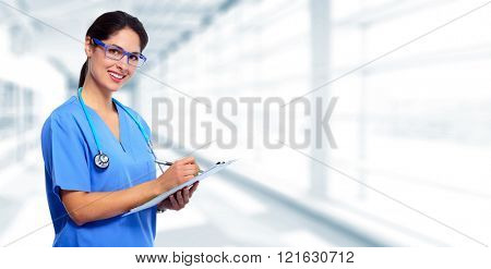 Medical doctor writing prescription.