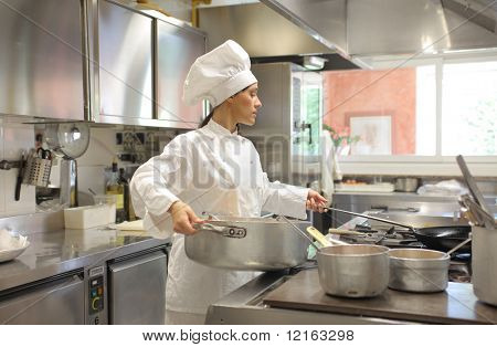 Female cook preparing food in a restaurant kitchen