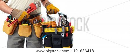 Builder handyman with construction tools.
