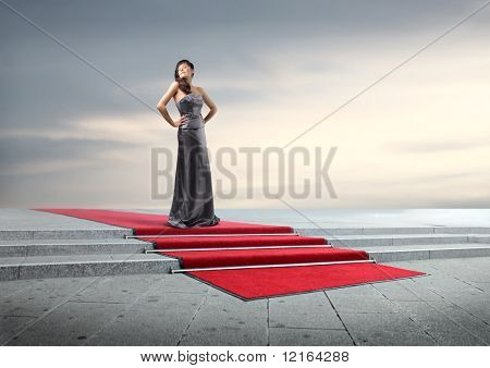 Beautiful elegant woman on a red carpet