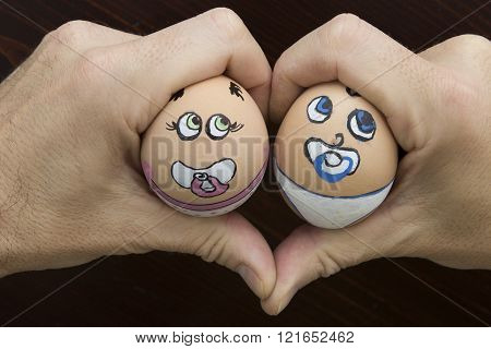 Man Hold Baby Egg Face