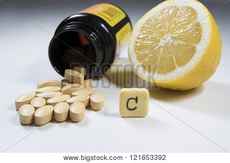 Vitamin C  Lemon And Bottle On White