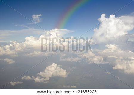 Clear Blue Sky With White Cloud And Rainbow