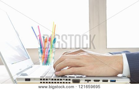 Businessman Hand Typing Laptop Or Notebook In Close Up View In Old Office