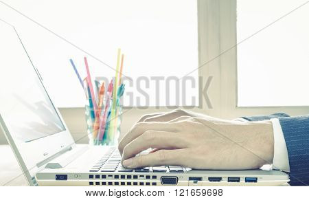 Businessman Hand Typing Laptop Or Notebook In Close Up View Vintage