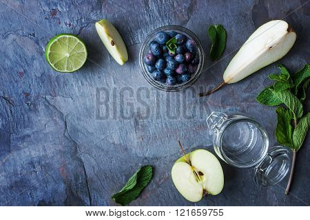 Ingredients for smoothie from apple pear and blueberry on the stone table