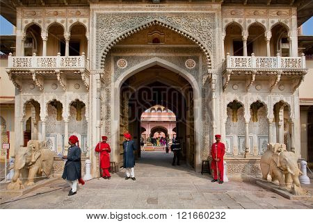 JAIPUR, INDIA - JAN 24: Guards in traditional costumes standing on the front of entrance gate of 18th century City Palace on January 24, 2015. Jaipur with populat. 6664000 is a capital of Rajasthan