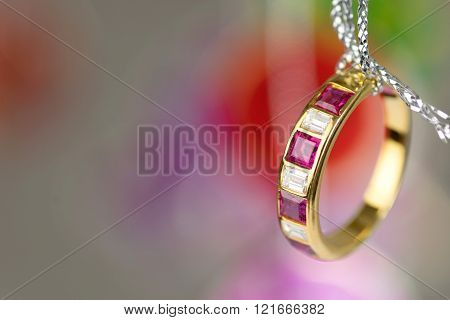 gold ring with square diamond ruby