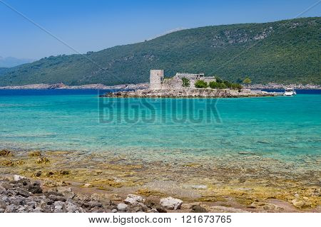 Mirista small fortress on the island in turquoise Adriatic bay