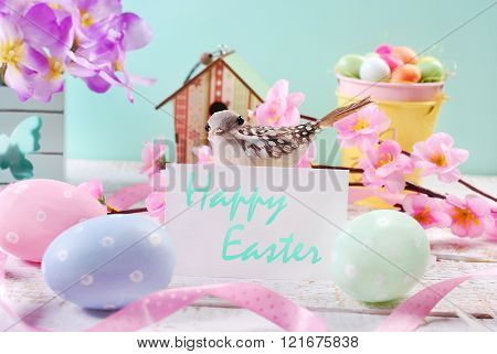 Easter Background  With Pastel Eggs And White  Card With Greetings